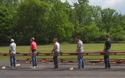 Volunteers Installation a Fiberglass Pedestrian Bridge