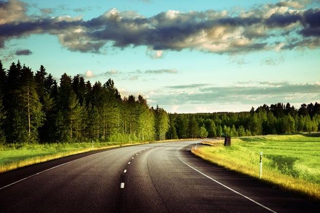Asphalt road in forest.jpeg