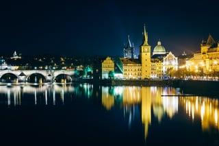 Charles Bridge and buildings along the Vltava at night, in Prague, Czech Republic..jpeg