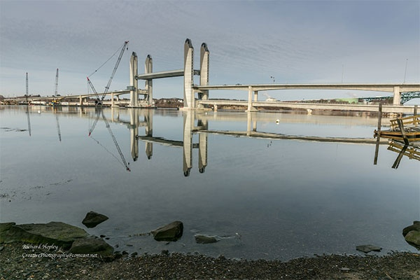 4 - SL - The lift span can raise to allow ships to pass beneath, or lower to allow the train to use the lower deck.jpg